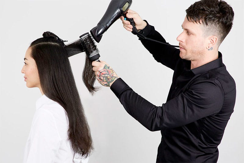 How To: Bouncy Half-Up Pony Step 4 of 14. Blow dry with a round brush.