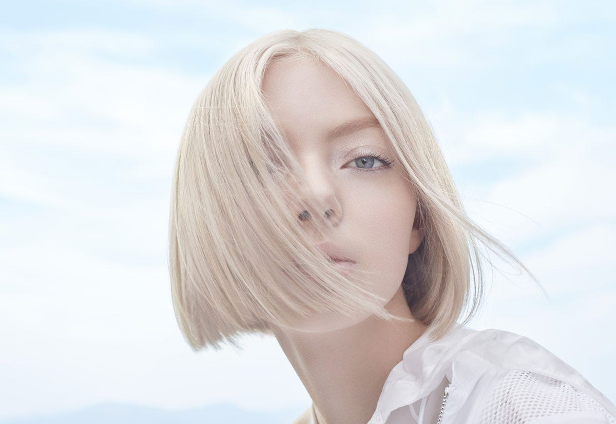 A model in the process of getting her hair colored. In this image the model's hair is blond and beautiful.