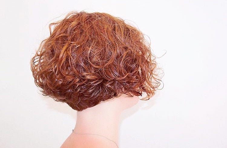 Short Curly Hairstyle via @ivanduda