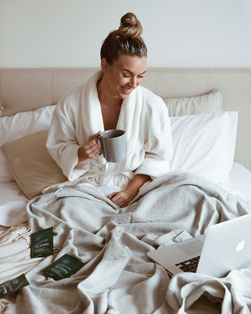 image of tea tree model sitting in bed