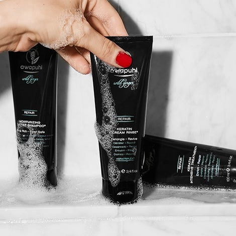 Image of Awapuhi Wild Ginger Keratin Cream Rinse covered in suds
