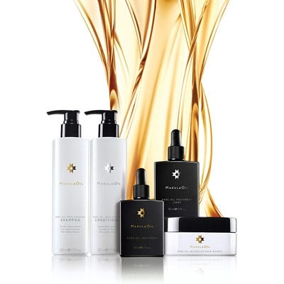 artistic image of the marulaoil replenishing and treatment collection product lineup