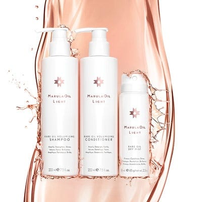 artistic image of the marulaoil volumizing collection product lineup